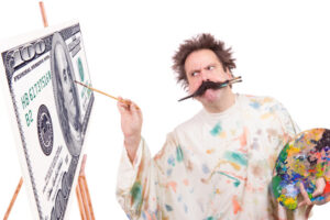 Concentrated painter paints a picture of banknotes